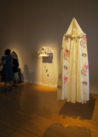 'Red Riding Hood's Cloak' next to 'The Wolf's House', 2012, by Jane Lee McCracken