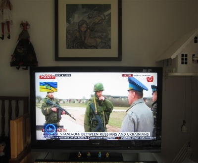 Still photograph of this morning's Sky News bulletin as the crisis deepens in Ukraine.  Ukrainain soldiers attempt to negotiate command of their headquarters with Russian soldiers who fired into the air upon their unarmed, flag carrying approach.