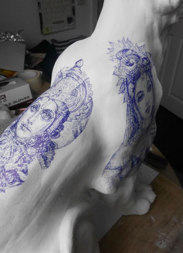 Vishnu and Lakshmi blue Biro tattoos on Tiger Sculpture