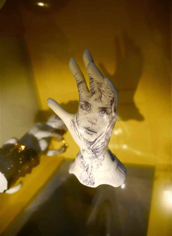 Sculpture tattoo on glass shelf.